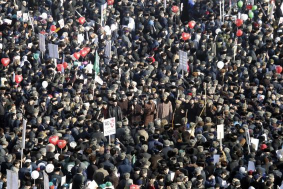 """People attend a rally titled """"Love for the Prophet Mohammad"""" to protest against satirical cartoons of the prophet, in Grozny, Chechnya"""